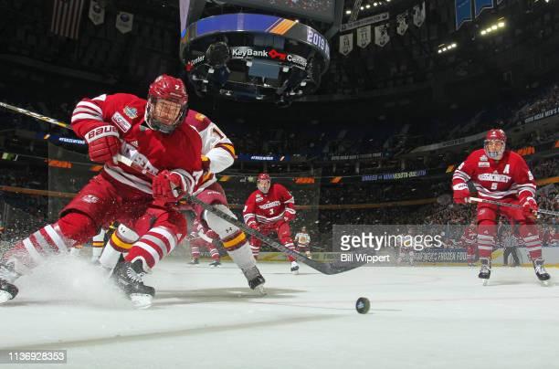 Kurt Keats of the Massachusetts Minutemen controls the puck against the MinnesotaDuluth Bulldogs during the Division I Men's Ice Hockey Championship...