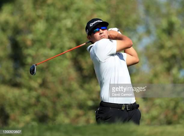 Kurt Kitayama of the United States plays his tee shot on the third hole during the final round of the Abu Dhabi HSBC Championship at Abu Dhabi Golf...