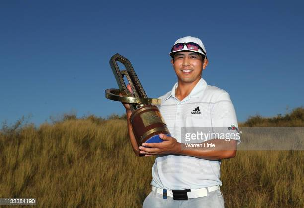 Kurt Kitayama of USA holds the winners trophy after winning the Oman Golf Classic at Al Mouj Golf on March 03, 2019 in Muscat, Oman.