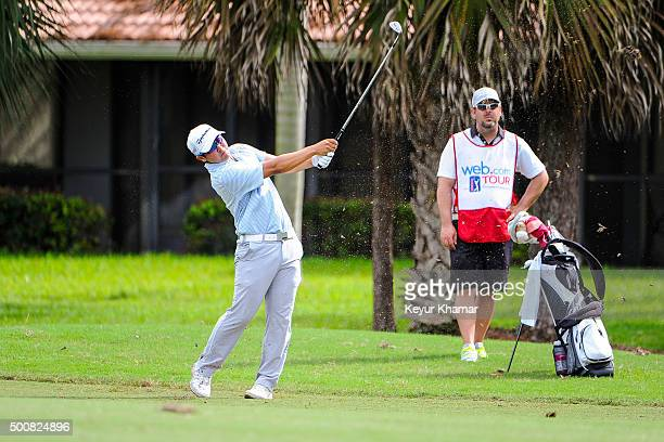 Kurt Kitayama plays his approach shot on the ninth hole as his caddie watches on the Fazio Course during the first round of Webcom Tour QSchool at...
