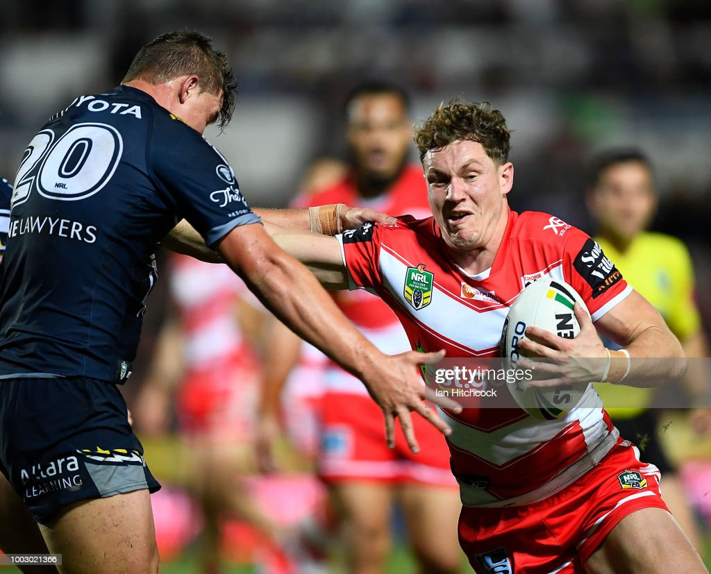 Kurt Mann of the Dragons is tackled by Mitchell Dunn of the Cowboys during the round 19 NRL match between the North Queensland Cowboys and the St George Illawarra Dragons at 1300SMILES Stadium on July 21, 2018 in Townsville, Australia.