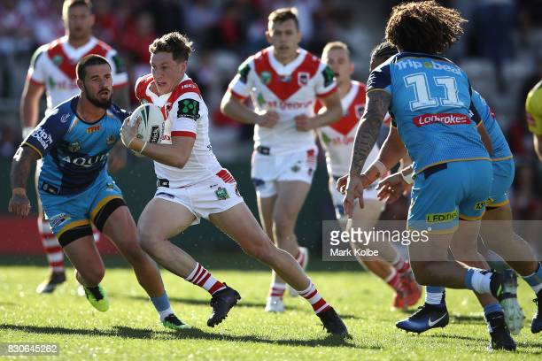 Kurt Mann of the Dragons makes a break during the round 23 NRL match between the St George Illawarra Dragons and the Gold Coast Titans at UOW Jubilee...