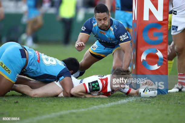 Kurt Mann of the Dragons scores a try during the round 23 NRL match between the St George Illawarra Dragons and the Gold Coast Titans at UOW Jubilee...