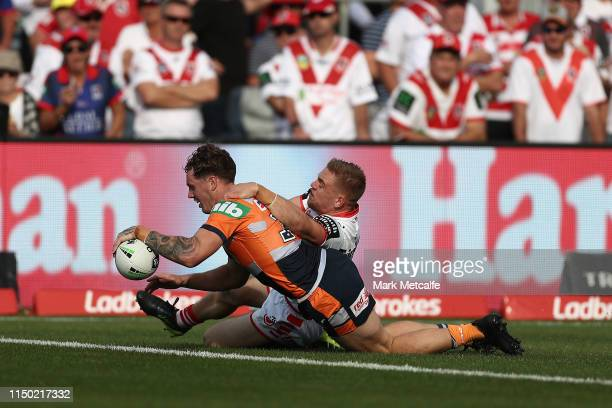 Kurt Mann of the Knights scores a try during the round 10 NRL match between the St George Illawarra Dragons and the Newcastle Knights at Glen Willow...