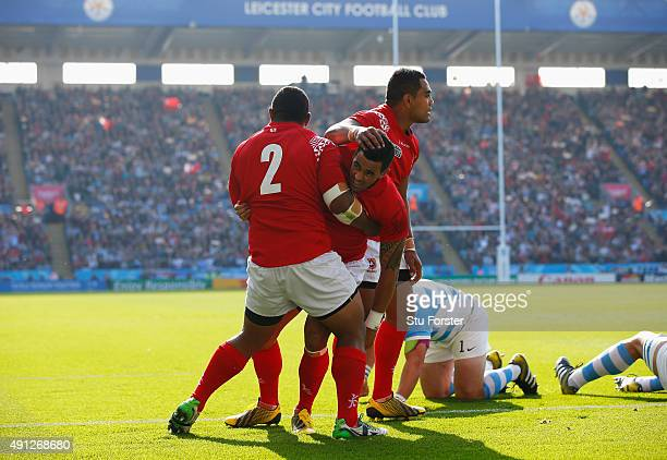 Kurt Morath of Tonga celebrates their first try with his team mates during the 2015 Rugby World Cup Pool C match between Argentina and Tonga at...