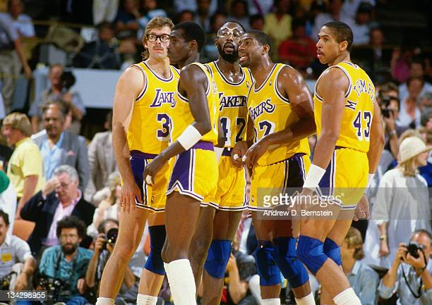 Kurt Rambis Michael Cooper James Worthy Magic Johnson and Mychale Thompson of the Los Angeles Lakers huddle up circa 1987 at the Great Western Forum...