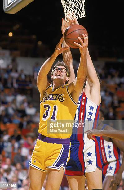 Kurt Rambis of the Los Angeles Lakers shoots a reverse layup during an NBA game against the Nerw Jersey Nets at the Great Western Forum in Los...