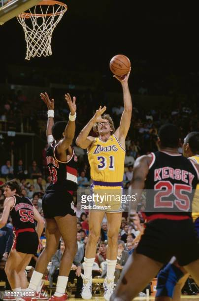 Kurt Rambis, Power Forward for the Los Angeles Lakers makes a one handed shot for the basket during the NBA Pacific Division basketball game against...