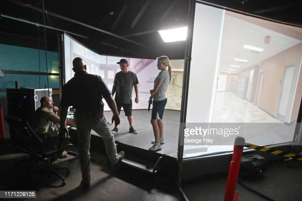 Kurt Robertson and Under Sheriff Shaun Bufton critiques Utah teachers Anthony Bowden and Holli Averett after they did a video simulator that created...