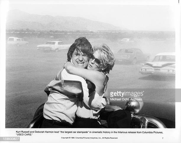 Kurt Russell and Deborah Harmon lead the largest car stampede in a scene from the film 'Used Cars' 1980