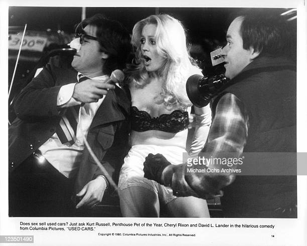 Kurt Russell Cheryl Rixon and David L Lander selling cars in a scene from the film 'Used Cars' 1980