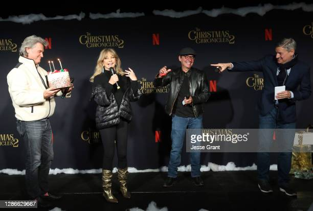 Kurt Russell, director/writer Chris Columbus and Netflix Co-CEO and Chief Content Officer Ted Sarandos present Goldie Hawn with a cake for her...