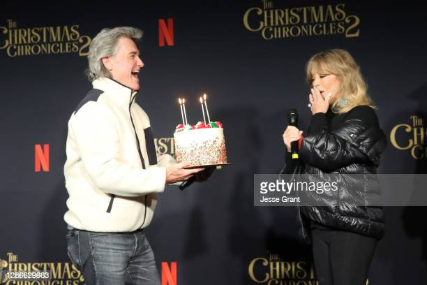 """Kurt Russell presents Goldie Hawn with a cake for her milestone birthday at Netflix's """"The Christmas Chronicles: Part Two"""" Drive-In Event at The..."""