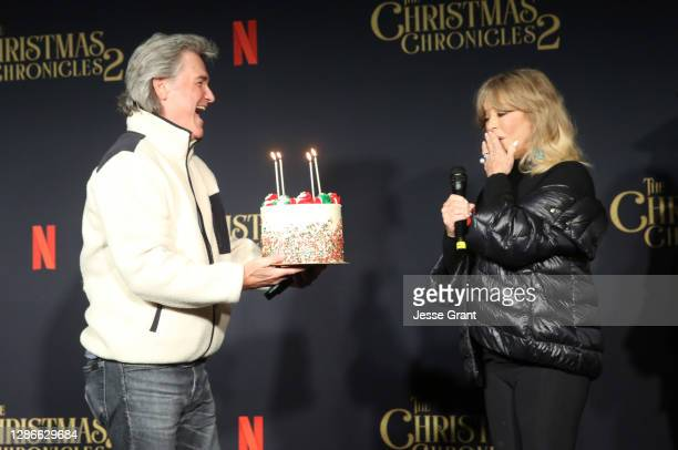 "Kurt Russell presents Goldie Hawn with a cake for her milestone birthday at Netflix's ""The Christmas Chronicles: Part Two"" Drive-In Event at The..."