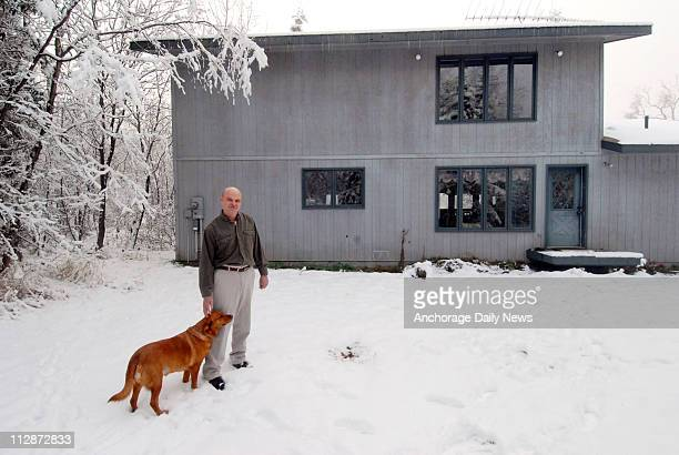 Kurt Sorensen stands with his dog Sadie near the spot where a brown bear that he legally shot and killed just 22feet from the backdoor of his Chugiak...