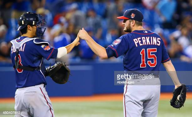 Kurt Suzuki and Glen Perkins of the Minnesota Twins celebrate the win against the Toronto Blue Jays during MLB action at the Rogers Centre June 10...