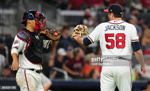 Kurt Suzuki and Luke Jackson of the Atlanta Braves celebrate after the game against the Philadelphia Phillies at SunTrust Park on September 22 2017...