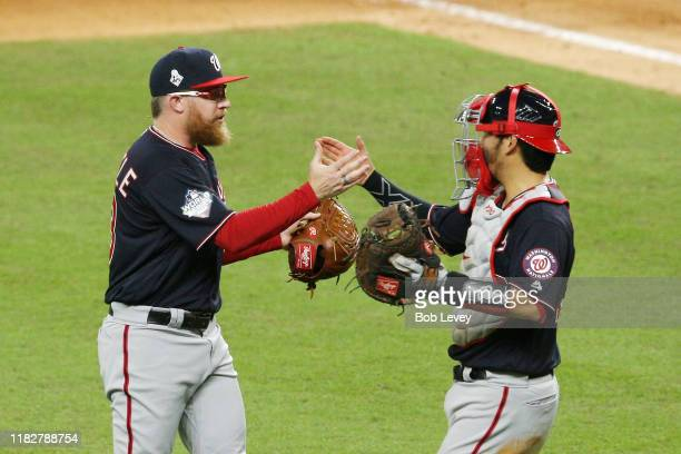 Kurt Suzuki and Sean Doolittle of the Washington Nationals celebrate their 54 win over the Houston Astros in Game One of the 2019 World Series at...
