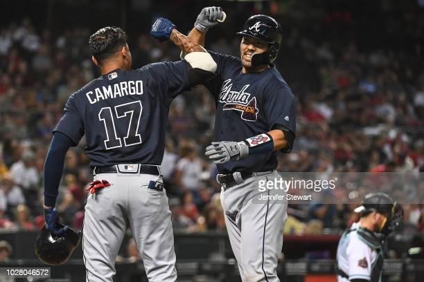 Kurt Suzuki of the Atlanta Braves celebrates a two run home run with Johan Camargo in the fourth inning of the MLB game against the Arizona...