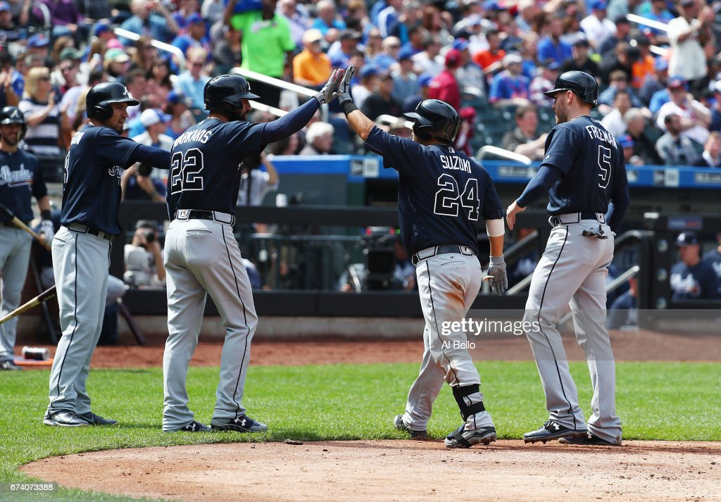 Kurt Suzuki #24 of the Atlanta Braves celebrates after hitting a three run home run against Matt Harvey #33 of the New York Mets in the fourth inning during their game at Citi Field on April 27, 2017 in New York City.