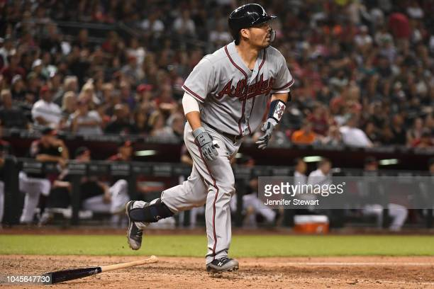 Kurt Suzuki of the Atlanta Braves flies out in the tenth inning of the MLB game against the Arizona Diamondbacks at Chase Field on September 8 2018...