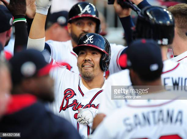 Kurt Suzuki of the Atlanta Braves is congratulated by teammates after hitting a first inning threerun home run against the Toronto Blue Jays at...