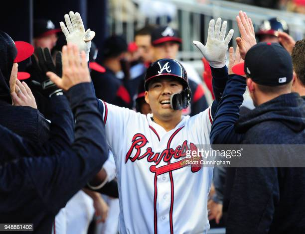 Kurt Suzuki of the Atlanta Braves is congratulated by teammates after hitting a first inning tworun home run against the New York Mets at SunTrust...