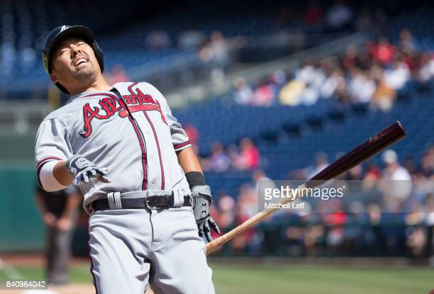 Kurt Suzuki of the Atlanta Braves is hit by a pitch in the top of the fourth inning against the Philadelphia Phillies in game one of the doubleheader...
