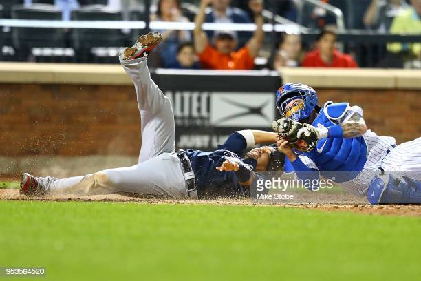 Kurt Suzuki of the Atlanta Braves is tagged out at home by Tomas Nido of the New York Mets trying to score on a Ryan Flaherty single in the seventh...