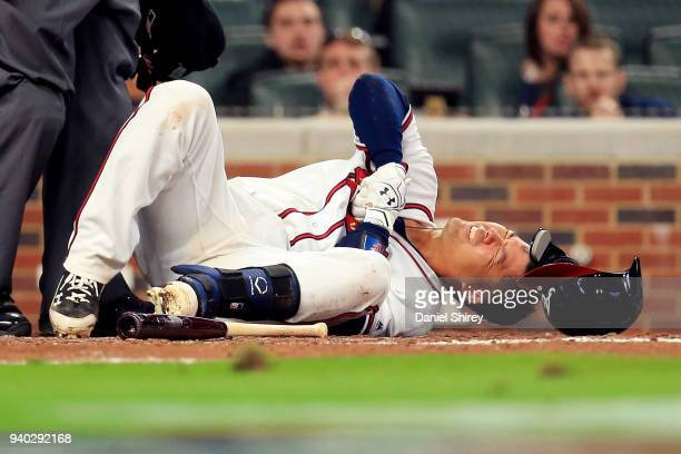 Kurt Suzuki of the Atlanta Braves reacts to being hit by a pitch during the fourth inning against the Philadelphia Phillies at SunTrust Park on March...