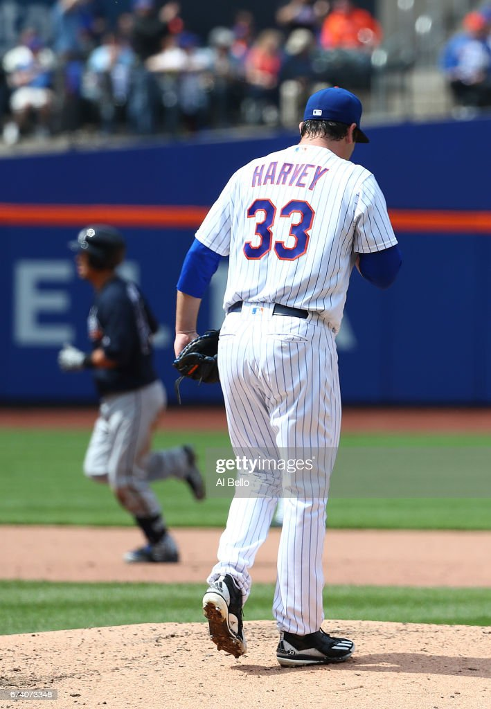 Kurt Suzuki #24 of the Atlanta Braves rounds the bases after hitting a three run home run against Matt Harvey #33 of the New York Mets in the fourth inning during their game at Citi Field on April 27, 2017 in New York City.