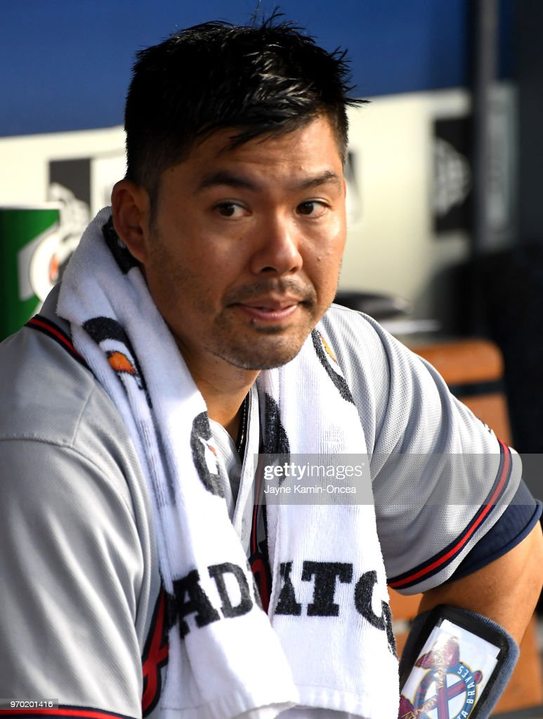 Kurt Suzuki #24 of the Atlanta Braves sits in the dugout during the game against the Los Angeles Dodgers at Dodger Stadium on June 8, 2018 in Los Angeles, California.