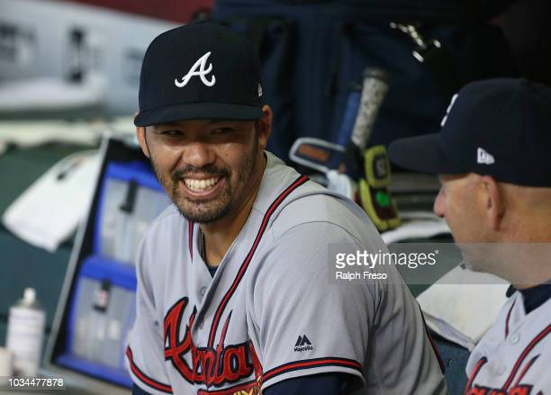 Kurt Suzuki of the Atlanta Braves talks with bench coach Walt Weiss of the Braves prior to an MLB game against the Arizona Diamondbacks at Chase...