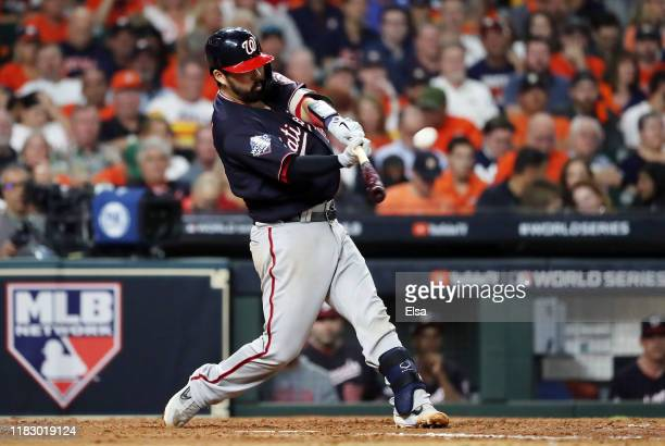 Kurt Suzuki of the Houston Astros hits a solo home run against the Houston Astros during the seventh inning in Game Two of the 2019 World Series at...