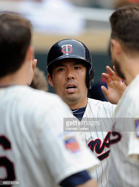 Kurt Suzuki of the Minnesota Twins celebrates scoring a run against the Houston Astros during the seventh inning of the game on June 7 2014 at Target...