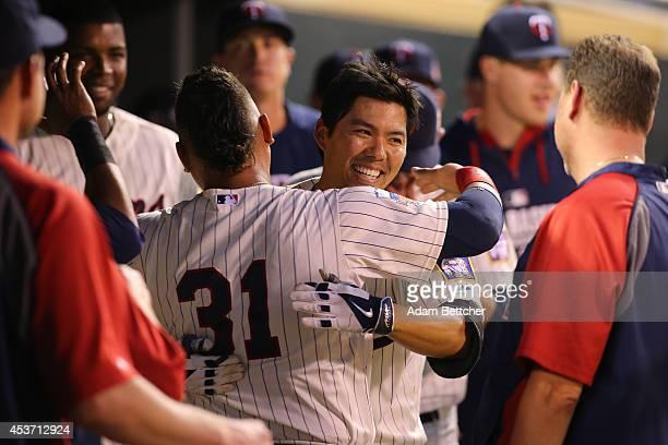 Kurt Suzuki of the Minnesota Twins celebrates with Oswaldo Arcia of the Minnesota Twins after a home run against the Kansas City Royals at Target...