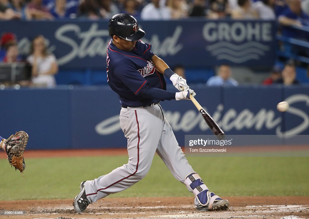 Kurt Suzuki #8 of the Minnesota Twins hits a two-run double in the fourth inning during MLB game action against the Toronto Blue Jays on August 26, 2016 at Rogers Centre in Toronto, Ontario, Canada.