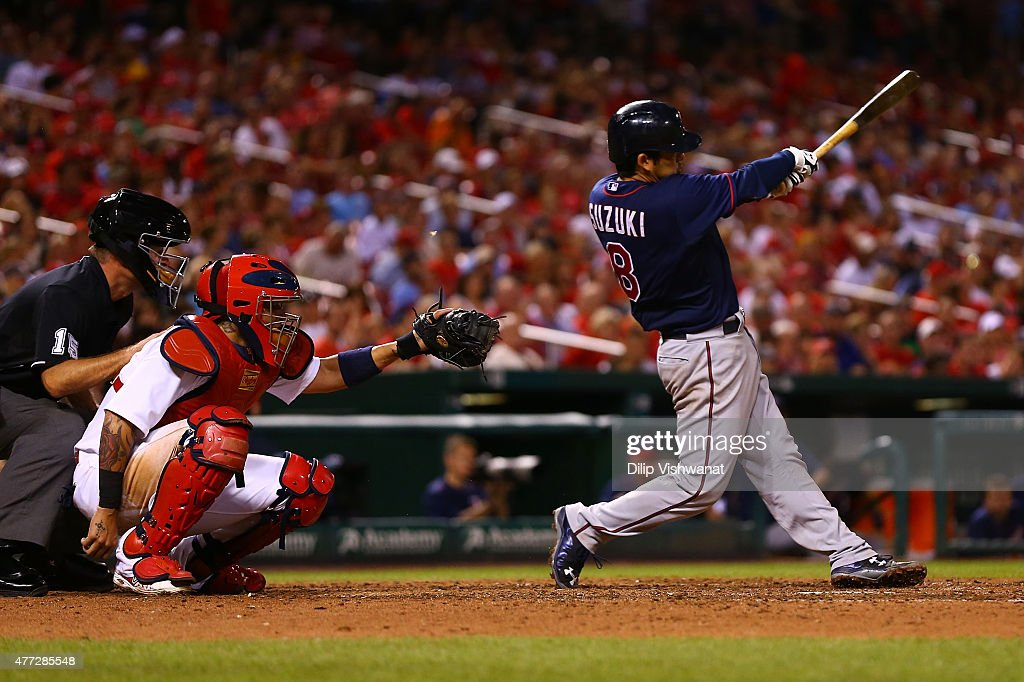 Kurt Suzuki #8 of the Minnesota Twins hits an RBI single against the St. Louis Cardinals in the seventh inning at Busch Stadium on June 15, 2015 in St. Louis, Missouri.