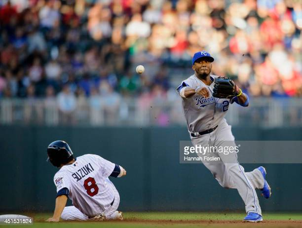 Kurt Suzuki of the Minnesota Twins is out at second base as Alcides Escobar of the Kansas City Royals attempts to turn a double play during the first...