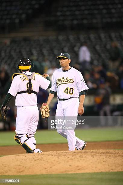 Kurt Suzuki of the Oakland Athletics congratulates Brian Fuentes after he picks up the save following the game against the Texas Rangers at the...
