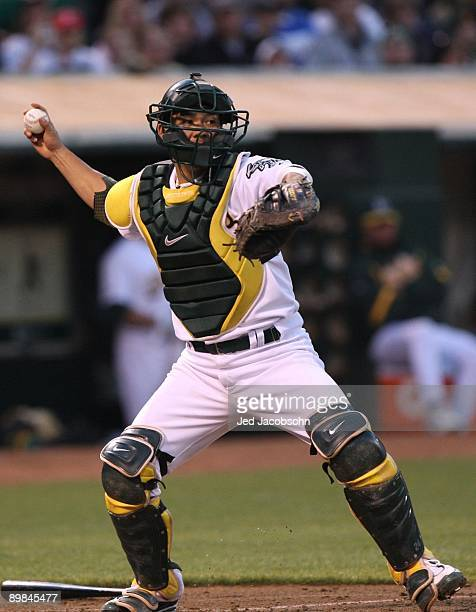 Kurt Suzuki of the Oakland Athletics throws to first base on a double play hit by Alex Rodrigues of the New York Yankees in the third inning of the...