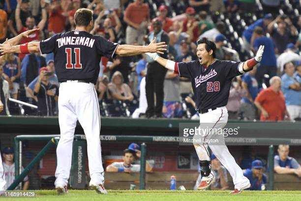 Kurt Suzuki of the Washington Nationals celebrates a walk off home run in the ninth inning with Ryan Zimmerman during a baseball game against the New...
