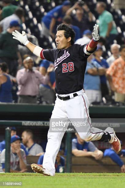 Kurt Suzuki of the Washington Nationals celebrates a walk off three run home run in the ninth inning during a baseball game against the New York Mets...
