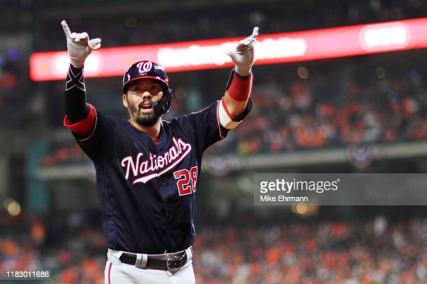 Kurt Suzuki of the Washington Nationals celebrates after he hits a solo home run against the Houston Astros during the seventh inning in Game Two of...