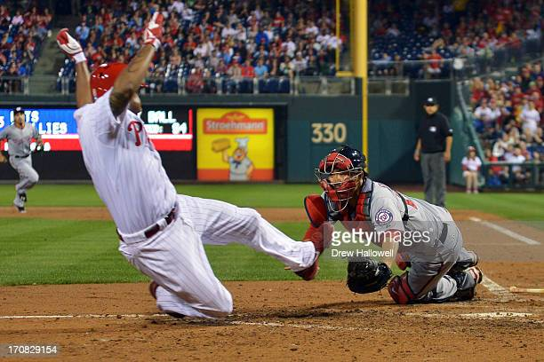 Kurt Suzuki of the Washington Nationals dives to put out Delmon Young of the Philadelphia Phillies in the fifth inning at Citizens Bank Park on June...