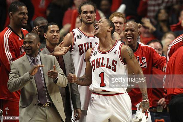 Kurt Thomas John Lucas III Joakim Noah Derrick Rose and Keith Bogans of the Chicago Bulls celebrate late in the fourth quarter against the Miami Heat...