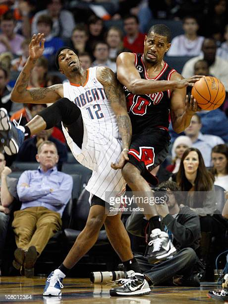 Kurt Thomas of the Chicago Bulls battles for a loose ball with Tyrus Thomas of the Charlotte Bobcats during their game at Time Warner Cable Arena on...