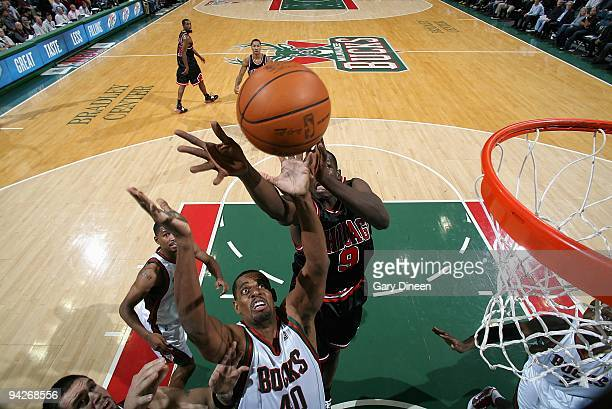 Kurt Thomas of the Milwaukee Bucks and Luol Deng of the Chicago Bulls go after a rebound during the game on November 30 2009 at the Bradley Center in...