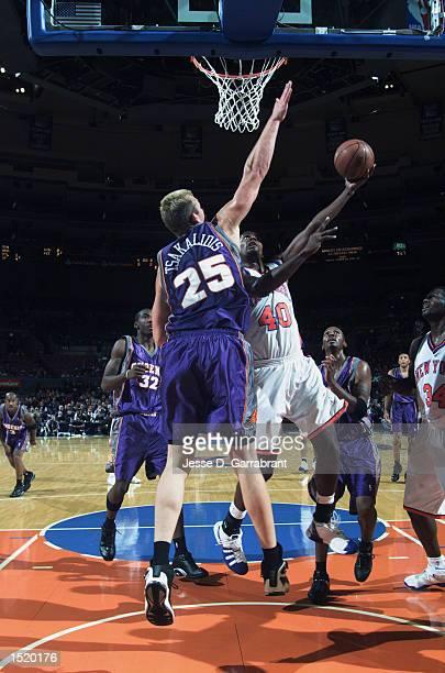 Kurt Thomas of the New York Knicks goes to the basket against Jake Tsakalidis of the Phoenix Suns during the preseason game on October 12 2002 at...