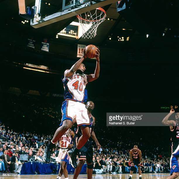 Kurt Thomas of the New York Knicks grabs a rebound against the Miami Heat in Game Four of the Eastern Conference Quarterfinals during the 1999 NBA...